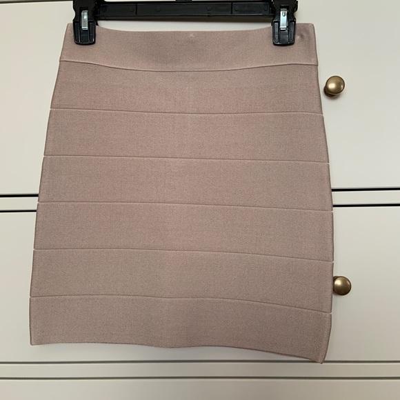bebe Dresses & Skirts - Bebe tan mini bandage skirt M